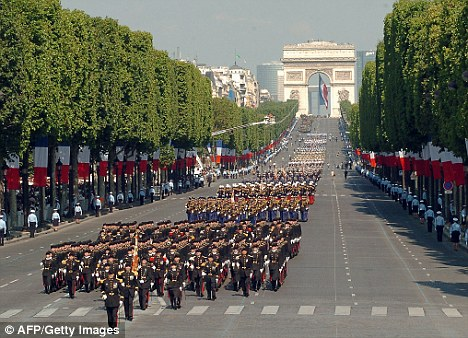 Troops march down the Champs Elysees during the Bastille Day parade